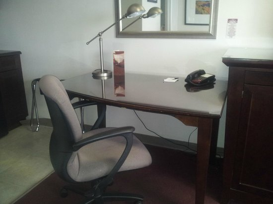 Saskatoon Thriftlodge: Large work glass top desk with ergonomic chair