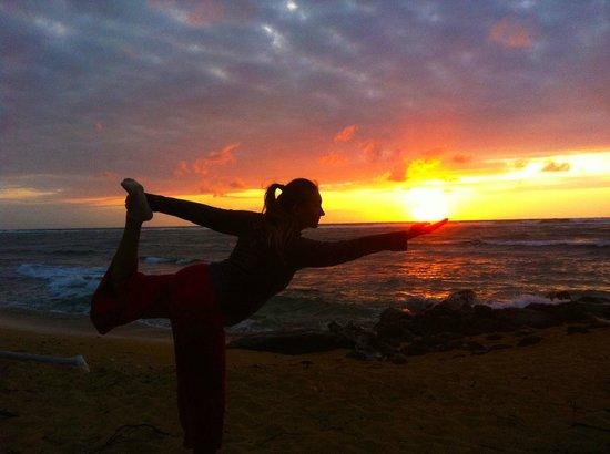 Kauai Yoga On The Beach Holding Sun