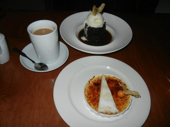 Brava Bistro: Gingerbread Cake with Vanilla Ice Cream (top) and Creme Brulee with Shortbread Cookie (bottom)