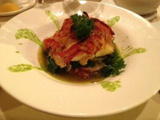 Costa Del Sol Restaurante: Bacalao House-cured codfish with onion and pepper comfit over sautéed baby spinach