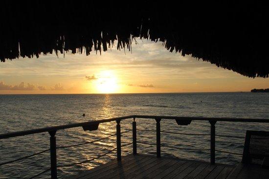 Conrad Bora Bora Nui: Sunset from our balcony in room 109