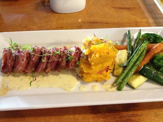 roadies cafe: The incredible pork dish with blue cheese sauce!