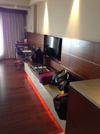 The Lalit New Delhi: desk and tv