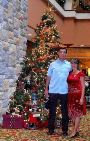 Chateau on the Lake Resort & Spa: Christmas photo in front of JUST ONE of the many beautifully decorated trees in The Lobby.