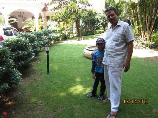 Ann's Residency: Dhinesh with Mr Fernandez at the well manicured garden.