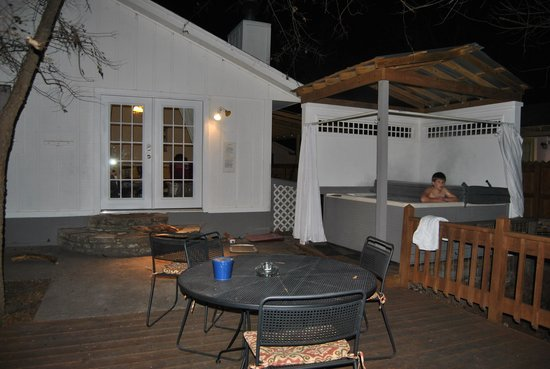 Cypress Creek Cottages: My son enjoying the hot tub on the back deck
