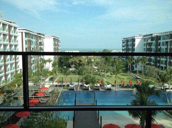 Amari Hua Hin: The view over the pool area in the day. The last two blocks that face each other are the condo's
