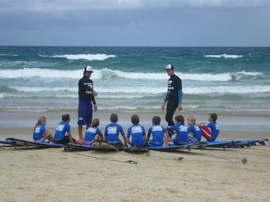 Coolum Surfing School: Pierre doing what he does best! Look how attentive the kids are, they LOVE him!
