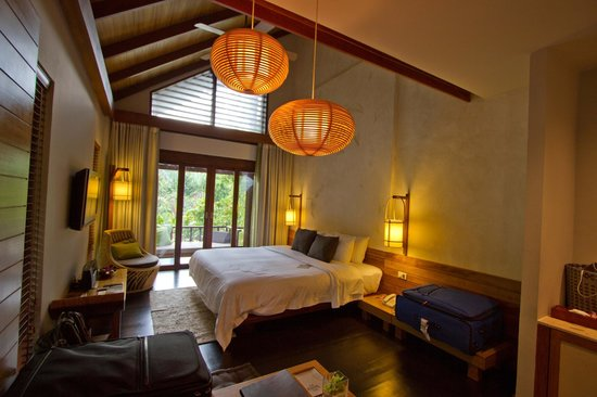 The Tubkaak Krabi Boutique Resort: The room, cathedral ceilings and view of the pool