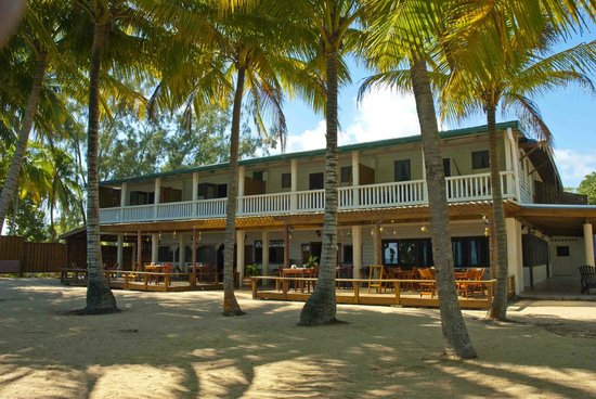 Pelican Beach - Dangriga: Main hotel building with dining patio on 1st level