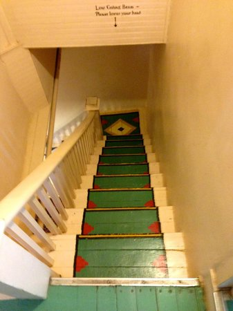 Mabel Dodge Luhan House: Stairway from the office to the 2nd floor guest rooms. 'Ware vertical clearances here!
