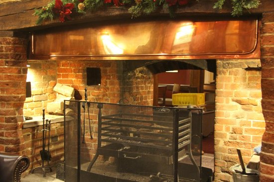The Bell Inn: Fireplace in the bar
