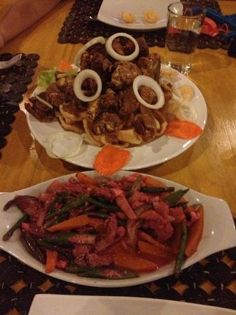 CouCou Bar & Restaurant: my pink Pinakbet and my husbands crispy Pata . lousy meals.