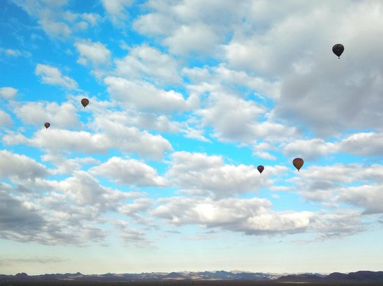 Hot Air Expeditions: going where the wind takes us...adrift among the clouds...