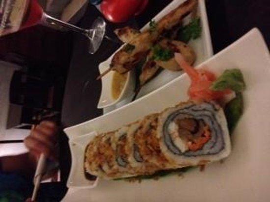 Manhattan Restaurant+Bar: surf & turf roll, chicken skewers