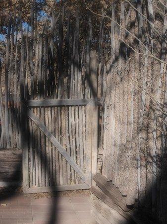 Hacienda Vargas: Latillas Fence on the Haceienda Courtyard Grounds