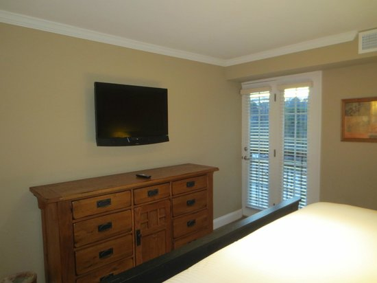 The Residences at Biltmore: Same bedroom with flat-screen TV and chest of drawers