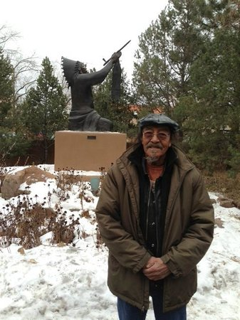 "Hotel Santa Fe, The Hacienda and Spa: Artist and tribal chief Gerald ""New Deer"" Nailor in front of statue he selected for the grounds"