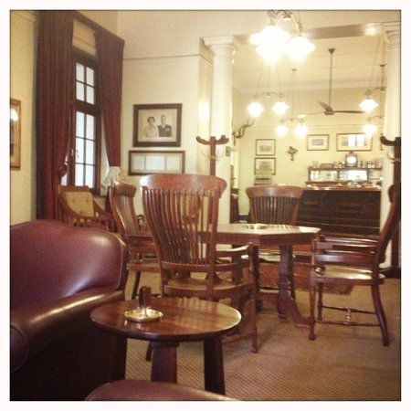 Kimberley Club: Bar area in the members lounge - the King's letter of thanks for the hospitality received on the