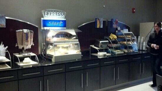 Holiday Inn Express & Suites Amarillo West: partial view of breakfast bar. complete with coffee area, pastries, milk, hard boiled eggs, cere