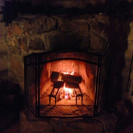 The Pines Cottages: Warm up by the Fire Place.