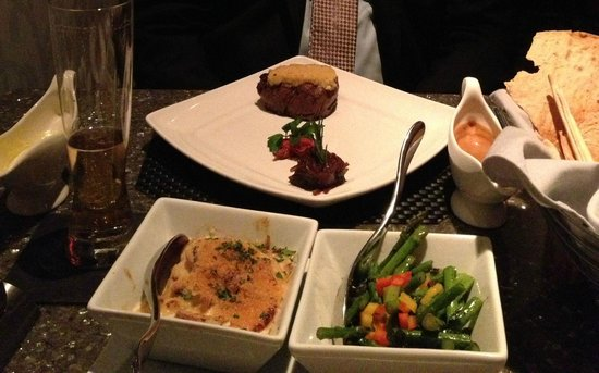 Nick & Nino's Penthouse Steakhouse: Filet with garlic topping, asparagus, potatoes