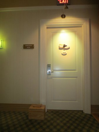 "Craddock Terry Hotel: The door to 401, with ""shoe-box"" placed outside for breakfast delivery"