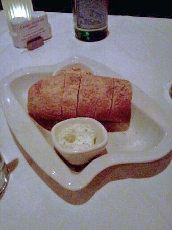 Fleming's Prime Steakhouse & Wine Bar: Crusty bread with 2 spreads - one tomato-based, one garlic