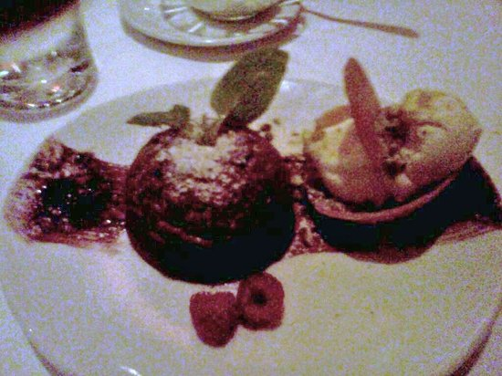 Fleming's Prime Steakhouse & Wine Bar: Molten chocolate lava cake, chantilly cream, ice cream in a cookie cup and raspberries