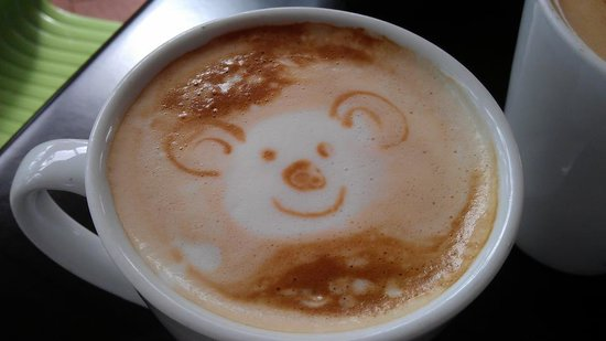 Cobbers Cove Cafe: Flat white coffee with a koala face drawn by Charlie the 12 year old daughter of the owners :-)