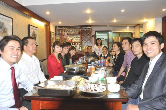 Icon 36 Hotel: Staff and management have a special meal to celebrate a record occupancy in November 2012