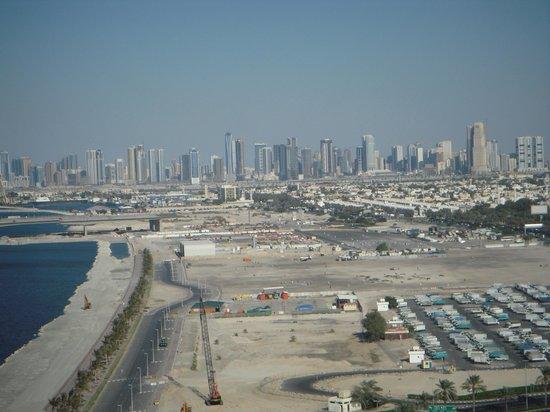 Al Dawaar: Sharjah in the distance
