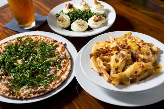 Robert Irvine's Nosh: Pork, blue cheese, and collard pizza. Deviled eggs. Pimento cheese and bacon fries.