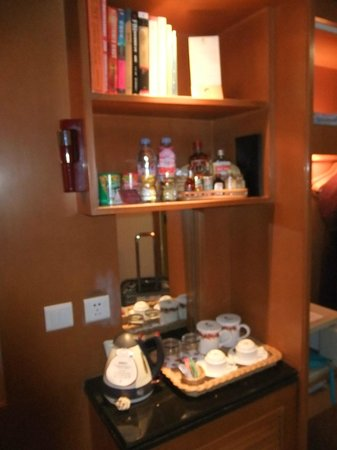 Culture Plaza Hotel Zhejiang: mini bar and book in room to read