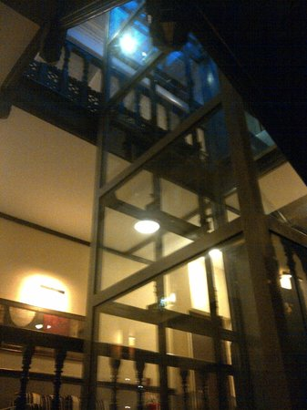 The Duke of Edinburgh Hotel: A modern glass elevator is fitted in the stairwell.