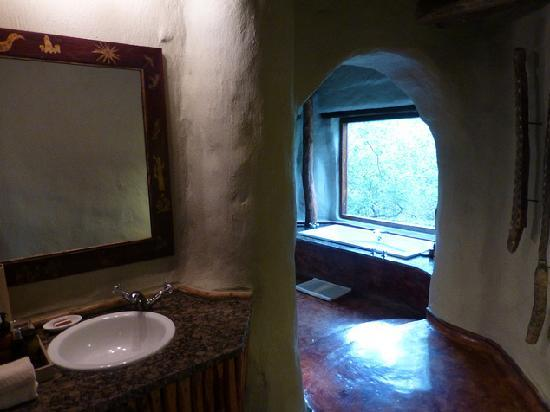 andBeyond Phinda Rock Lodge: view from basin room 5... toilet is on left in private room; bath and separate showers (indoor a