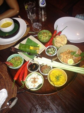 Bumbu Bali: Shredded chicken with lime, fish in banana leaves and mixed satay. It comes with rice & veg