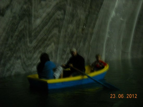 Turda Salt Mine: rowing a boat on a very salted lake