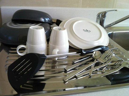 "GM Serviced Apartment: ""Cleaned"" dishes and cutlery"