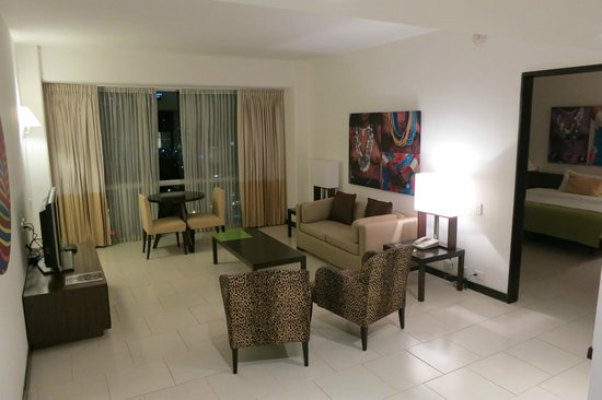 Radisson Decapolis Hotel Panama City: spacious living room with wet bar, mini fridge and half bath