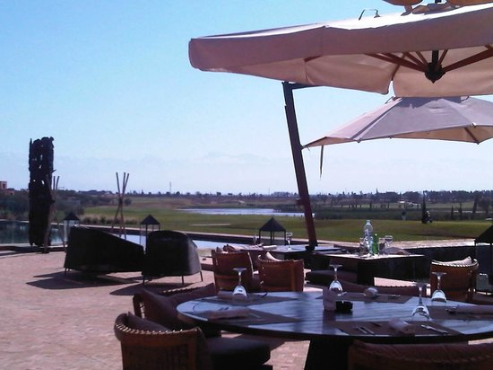 """Al Maaden Golf Resort : from the restaurant """"terrasse"""". the Atlas moutains at the back, the 18th hole in front."""