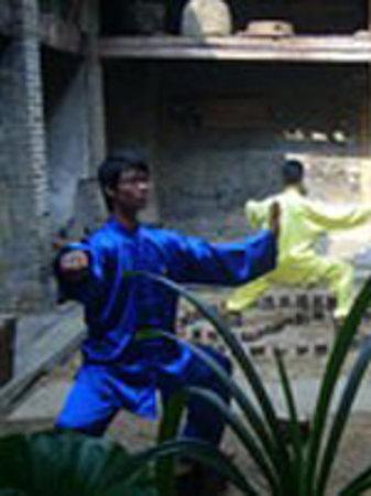 Yangshuo Traditional T'ai Chi School: Tai Chi Masters in the courtyard