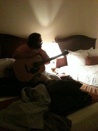 Best Western Plus Northshore Inn: my son playing his guitar