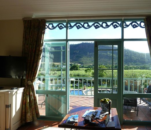 Franschhoek Country House & Villas: view from bedroom overlooking pools