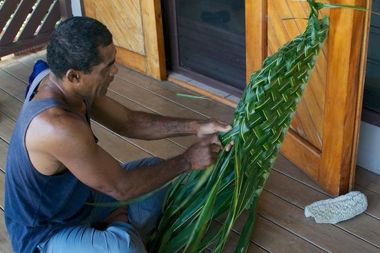 Coconut Grove Beachfront Cottages: Weaving a basket out a single palm leaf