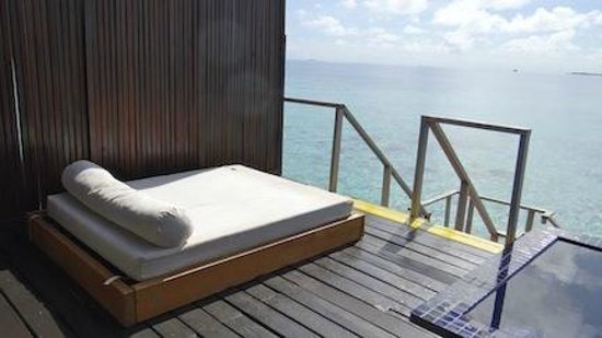 Adaaran Prestige Vadoo: Our own sunlounger next to our plunge pool and stairs to our private lagoon