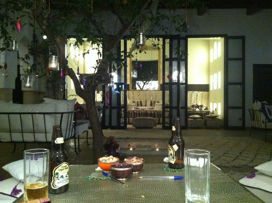 Dar Charkia: Two sides of the courtyard in the evening, with delicious food made by staff