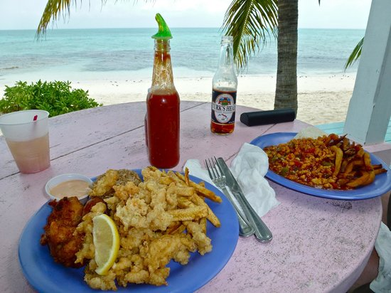 da Conch Shack: Cracked conch and fritters for me; creole conch for him...