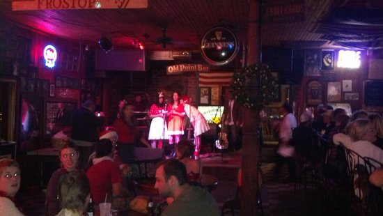 Algiers Point: xmas carollers performing at the Old Point bar