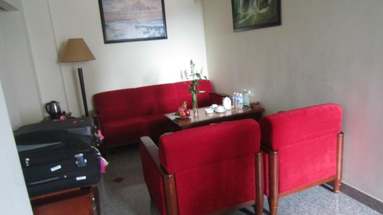 A&Em Signature Hotel: the red sofa in our room
